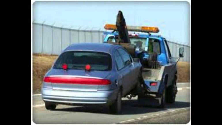 Dejan en libertad a operador de grúa que transportaba coche con arsenal