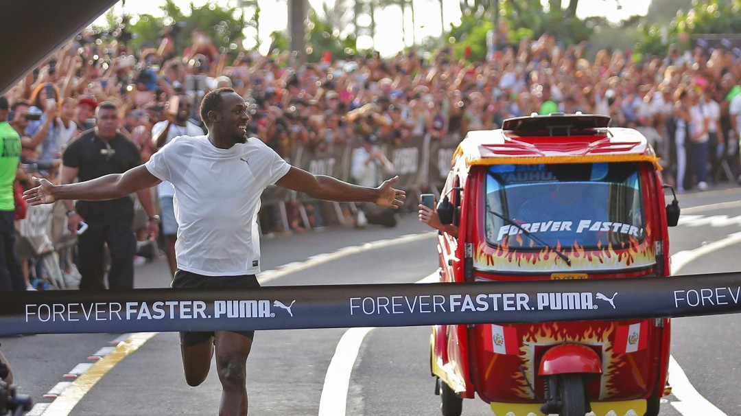 La increíble carrera de Usain Bolt contra un taxi