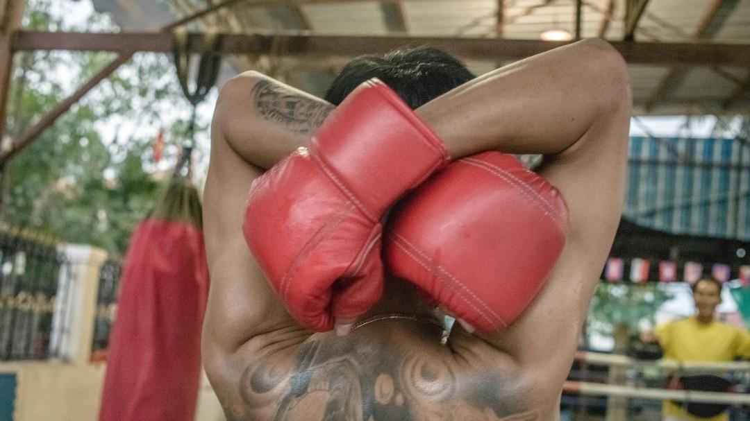 Kash Ali, el boxeador mordió la panza de su rival