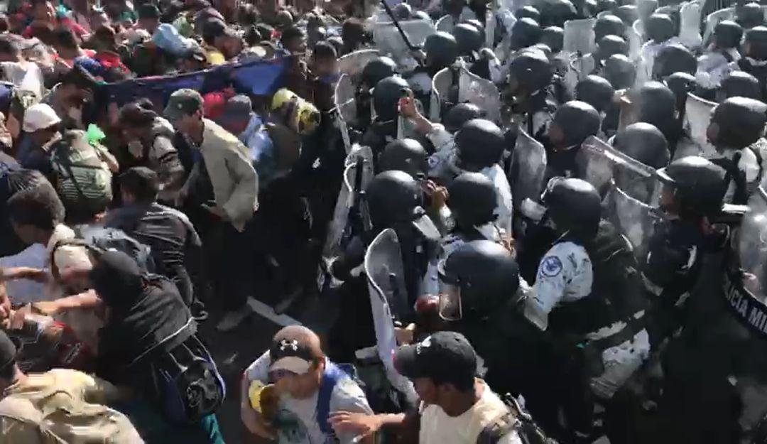 Guardia Nacional frena avance de caravana migrante